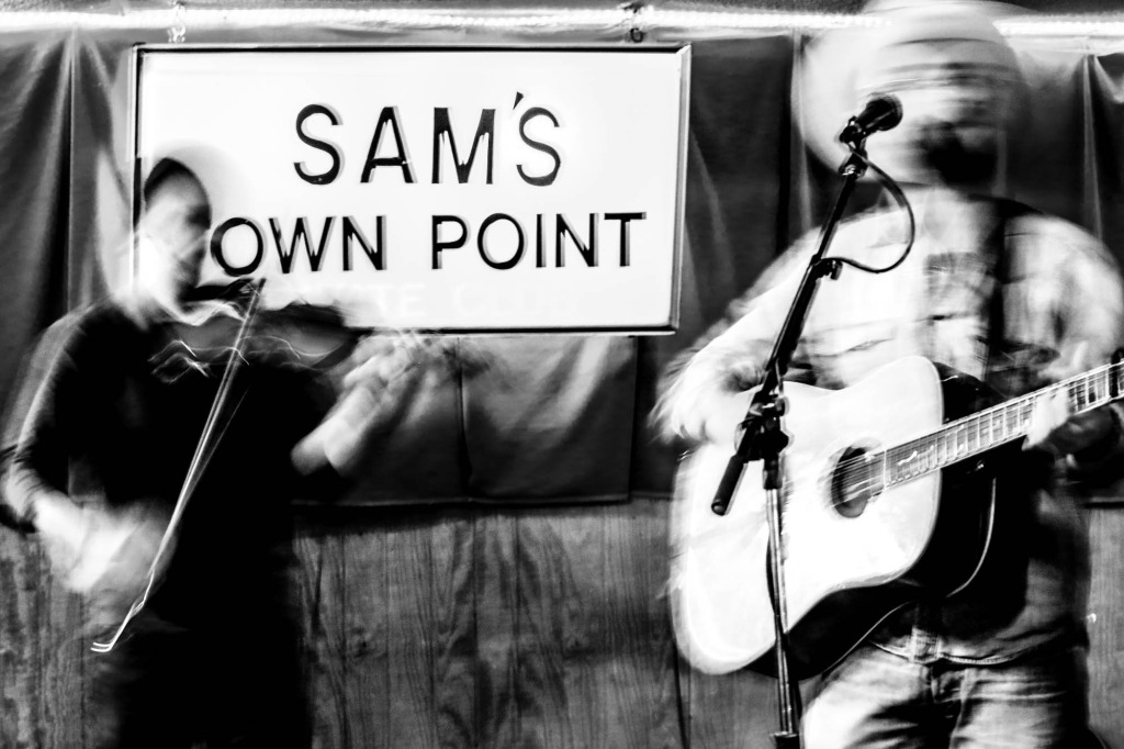 Lee Jaster and Benjamin Levy (violin) at Sam's Town Point in Austin, TX. Photography by Geofferson Cole.